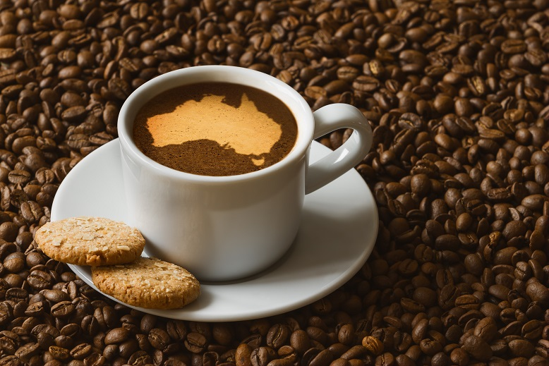 Still life photography of hot coffee beverage with map of Australia
