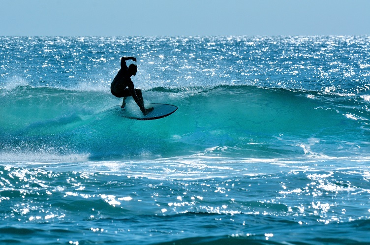 SURFERS PARADISE, AUS - OCT 14 2014: Surfer surfing in Main beach.It's a very popular surfing beach in Surfers Paradise Gold Coast Queensland, Australia.